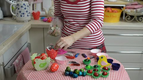 Woman painting quail eggs for the Easter Day