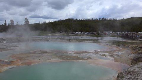 Biscuit Basin at rain. Black Opal Pool above the Firehole River. Yellowstone NP, Wyoming, USA