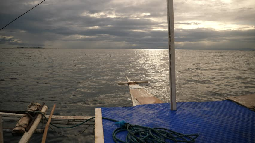 CEBU ,PHILLIPINES - CIRCA January 2018 :old catamaran boat moving through ocean   Shutterstock HD Video #1008364222