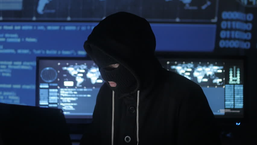 Dangerous hacker in the mask tries to enter the system using codes and numbers to find out the security password. The concept of cybercrime. | Shutterstock HD Video #1008364942