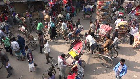 DHAKA, BANGLADESH - DECEMBER 2014: Busy street scene with cycle rickshaws in downtown Dhaka, Bangladesh