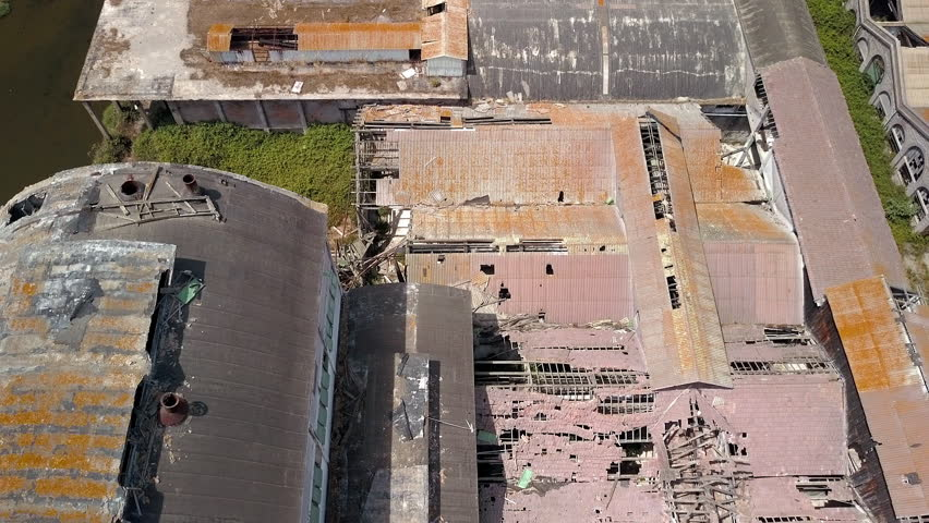 Aerial view of the ruined roofs of the factory in Orbetello in Italy | Shutterstock HD Video #1008390682