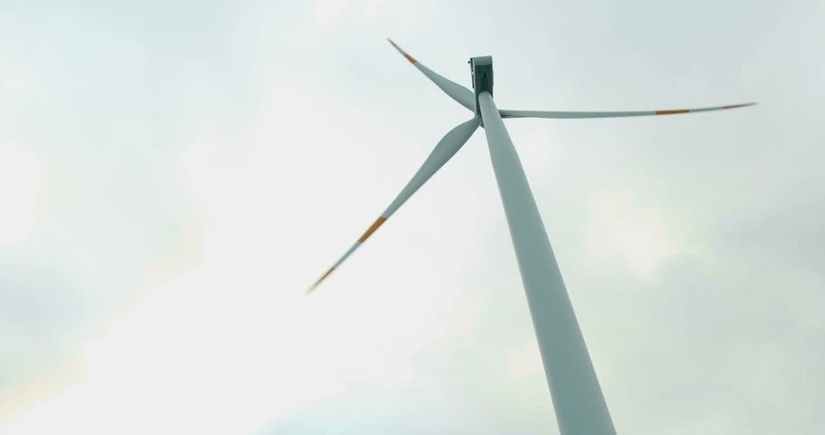 Wind farm towers turbine on the mountain to produce clean and renewable electric energy.