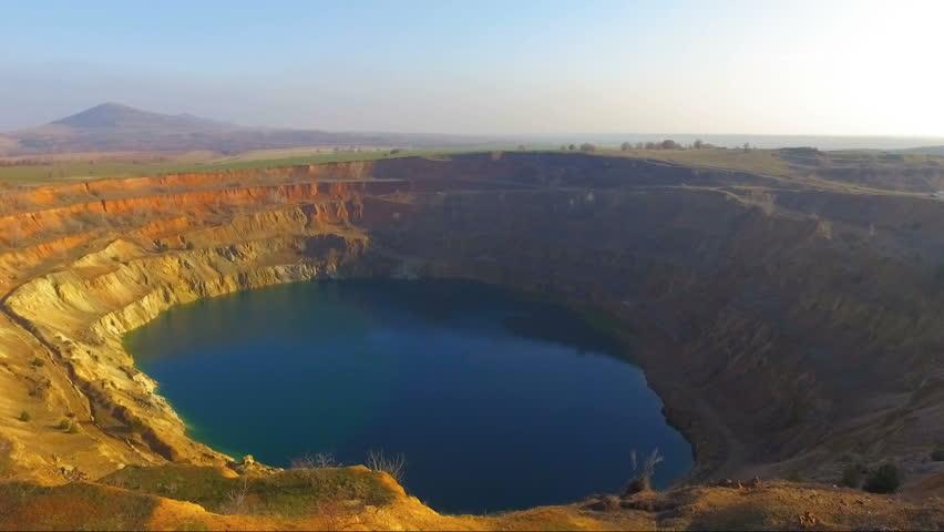 Flying into an abandoned mining crater creating a vertigo effect