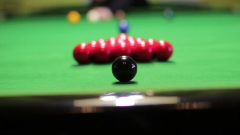 The initial blow to the pyramid of balls in snooker