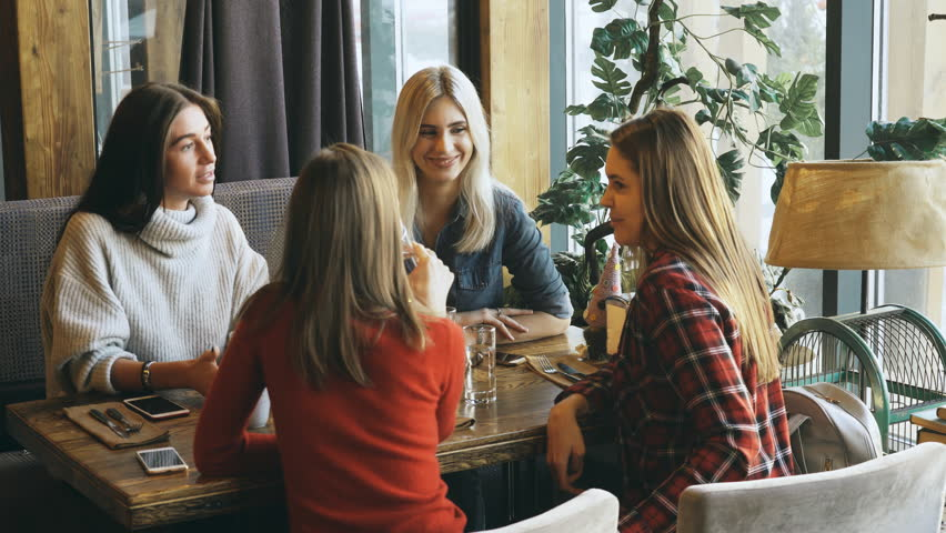 Four friends have Breakfast in a cafe and communicate | Shutterstock HD Video #1008456082