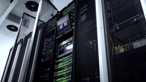 Working data servers with flashing LED lights. Motion shot. Data room full of servers. Telecommunications. There is little noise