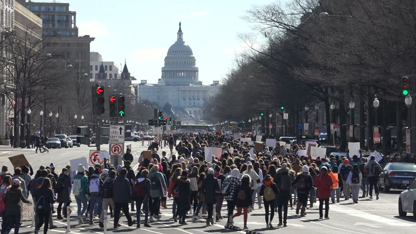 WASHINGTON, DC - MAR. 14, 2018: Students from area high schools during National School Walkout, protesting government's inaction on gun control, march from White House to Capitol on Pennsylvania Ave.