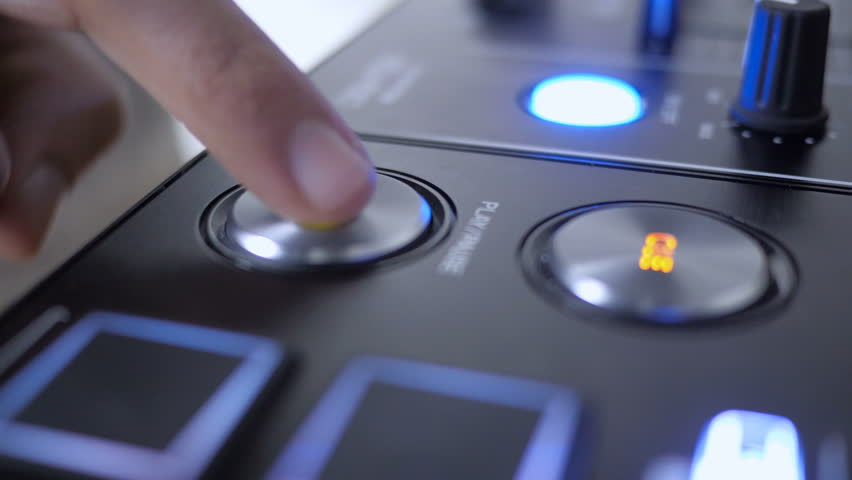Close Up of Finger Pressing the Play Button of Dj Instrument