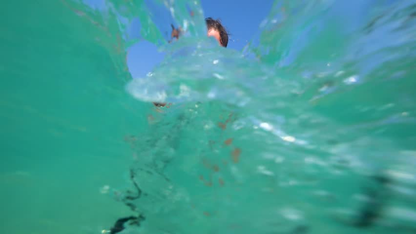 A man dives into a crystal clear sea in a mask 4k   Shutterstock HD Video #1008605092