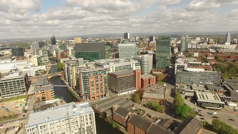 Manchester UK Aerial View Panning Right Shot With Canal, smooth tracking shot. 4K UHD or HD.