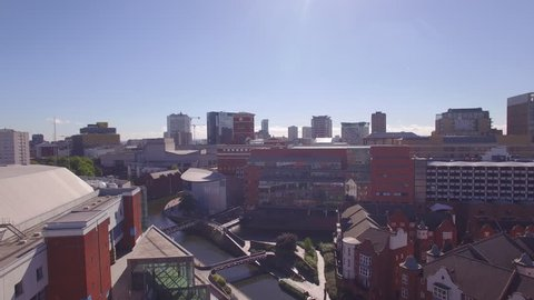 4K & HD Aerial Video clip of Brindley place and Canals, crane shot, with city landscape of Birmingham UK.