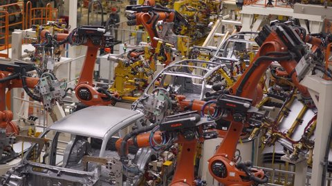 BELARUS, BORISOV - OCTOBER 19, 2017: Automobile plant, robot equipment, welding process, modern production of cars, automated production line, car body assembly process, October 19 in Belarus.