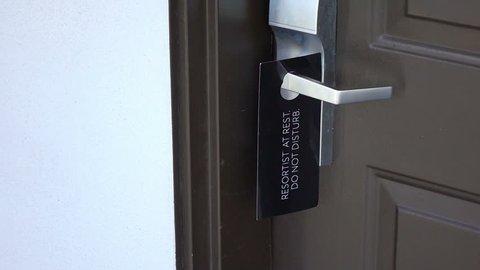 Professional video of do not disturb door sign in slow motion 250fps