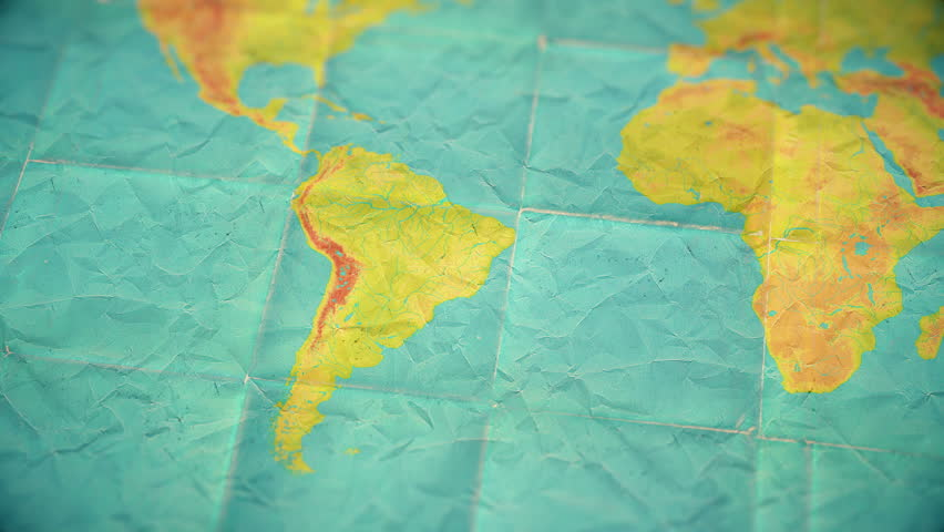 Zoom in from World Map to South America. Old well used world map with crumpled paper and distressed folds. Muted vintage colors. Blank version  | Shutterstock HD Video #1008684802