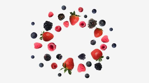 blueberries, strawberries, blackberries and raspberries fly in different directions. alpha channel