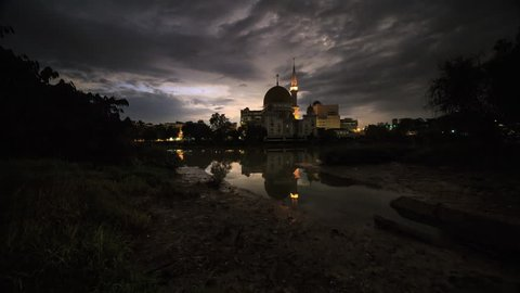 Beautiful sunrise time lapse at the Royal Mosque with the reflection by the Klang river, Selangor, Malaysia. 4K UHD.