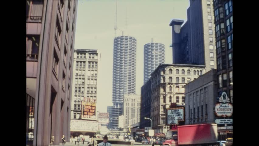 Chicago, 1960s: Vintage View of Marina City, skyscrapers, signs and shops of Downtown, on 1961 in Chicago, USA