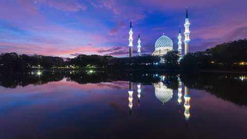 Sunrise Time Lapse at Masjid Sultan Salahuddin Abdul Aziz in Shah Alam, Malaysia. Reflection in lake with beautiful scattered clouds. 4K