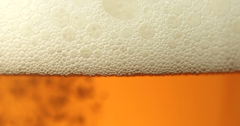 Slow motion shot of a beer poured into the glass - close-up #1008747212