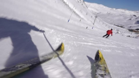 Skier Rips Down Slopes of Mountain and Falls Down