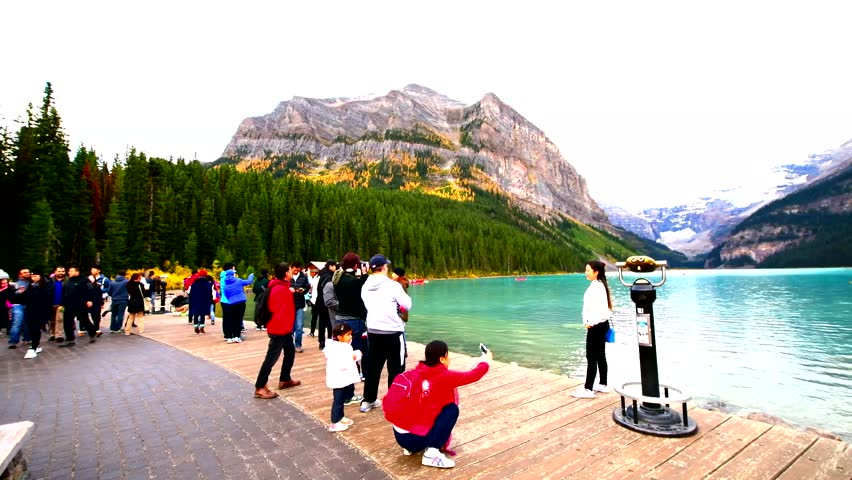LAKE LOUISE, CANADA -OCT 1, 2017: Large group of tourist watching view lake Louise from Fairmount Hotel. Lake Louise is the second most-visited destination in the Banff National Park.