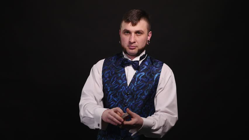 Magic, card tricks, gambling, casino, poker concept - man showing trick with playing cards | Shutterstock HD Video #1008822062