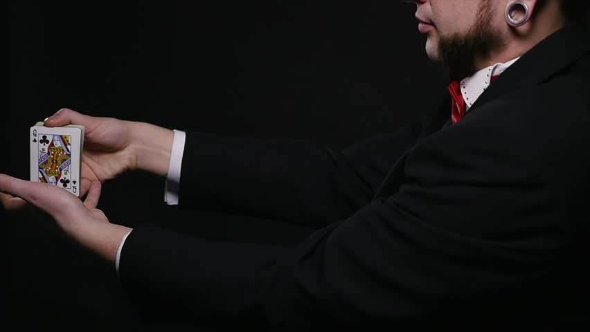Magic, card tricks, gambling, casino, poker concept - man showing trick with playing cards | Shutterstock HD Video #1008822332