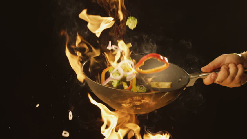 Chef Frying vegetables on fire throwing them in a frying pan | Shutterstock HD Video #1008828392