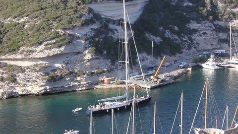 Sailing boat arriving in Bonifacio (Corsica)