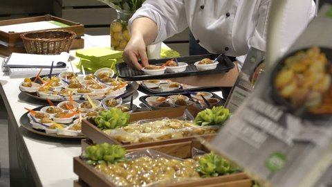 HELSINKI, FINLAND - MARCH 18,2018: The chefs prepare food samples and treat visitors during the Show Gastro Helsinki - big trade fair for the hotel, restaurant and catering industry
