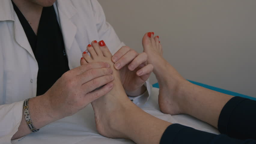 Podiatrist at work with a patient