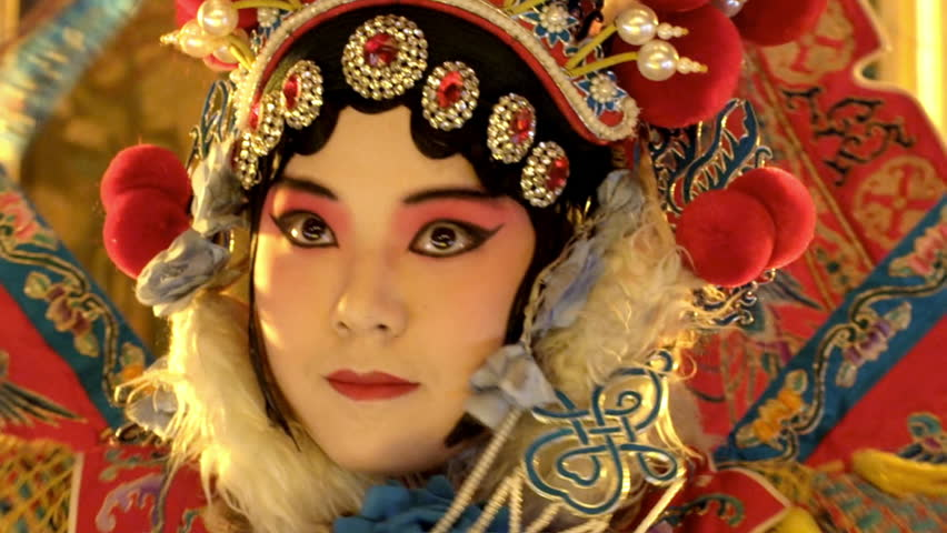Beijing  Opera actress striking a pose on the stage. | Shutterstock HD Video #1008869522