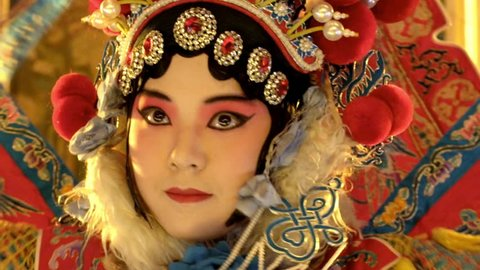 Beijing  Opera actress striking a pose on the stage.