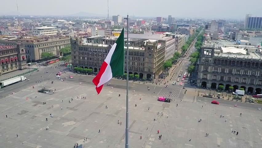Mexico City - aerial view, the zocalo in mexico city, with the giant flag in the centre, Mexican Flag waving high over Mexico, Constitution Plaza