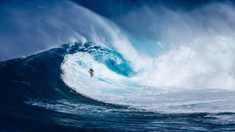 Surfer hangs motionless in middle of giant slow motion curling blue tropical wave on blustery summer day in this mesmerizing hypnotic endless loop cinemagraph plotagraph