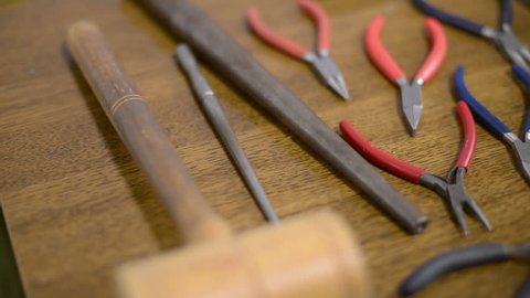 Old working tools for filigree production on wooden background