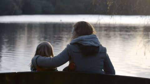 Woman and Child Looking Across a Lake