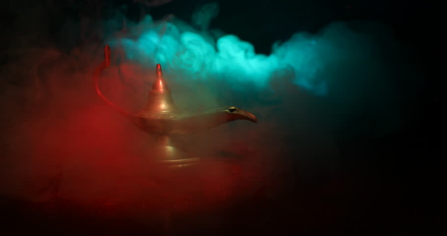 Slider shot.  Antique artisanal Arabian nights genie style oil lamp with soft light white smoke. dark smoky toned background. Lamp of wishes