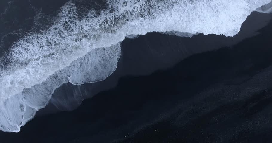 4k Aerial footage of waves on black sand beach in Iceland | Shutterstock HD Video #1009013102