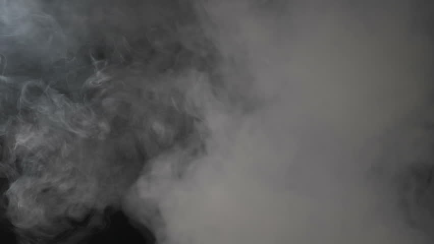 A cloud of white smoke emanating from the bottom of the frame and separating itself in two different parts in reverse as an abstract background | Shutterstock HD Video #1009090232