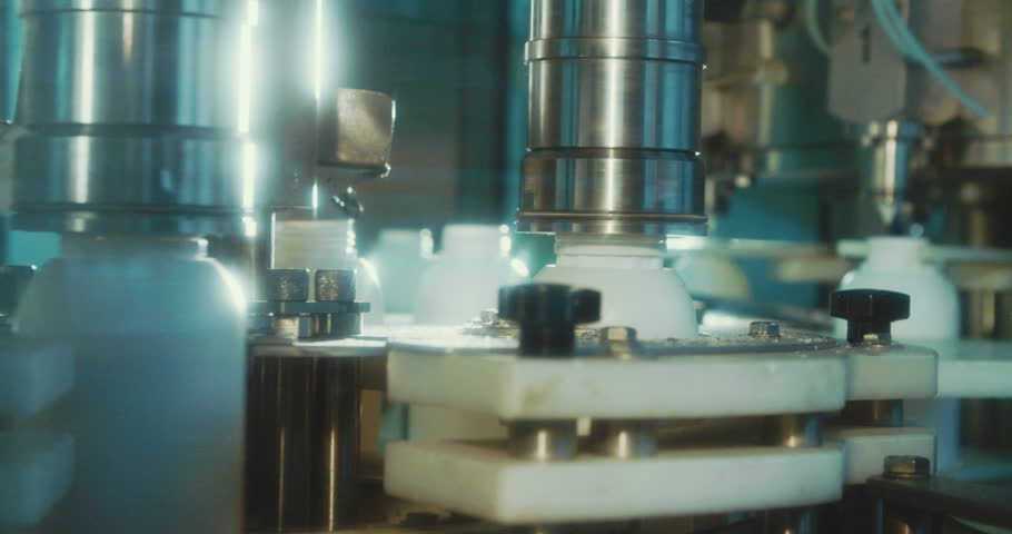 Machines in an automated chemical bottles production line | Shutterstock HD Video #1009119902