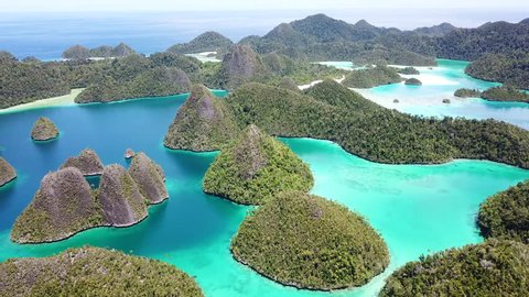 Beautiful limestone islands are found in the idyllic, tropical lagoon of Wayag, Raja Ampat, Indonesia. This unique, equatorial region is best known for its vast array of marine biodiversity.