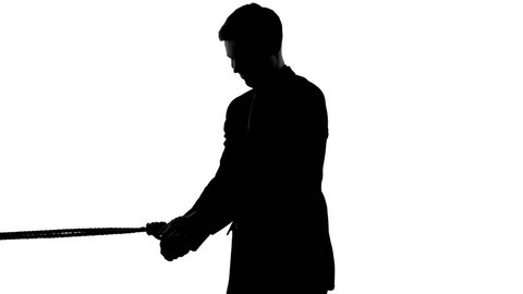 Shadow of man trying to free himself from strong bonds rope, tax burden problem