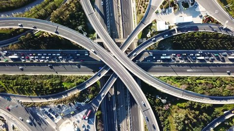Aerial drone bird's eye view video of popular highway of Attiki Odos multilevel junction road, passing through National motorway, Attica, Greece