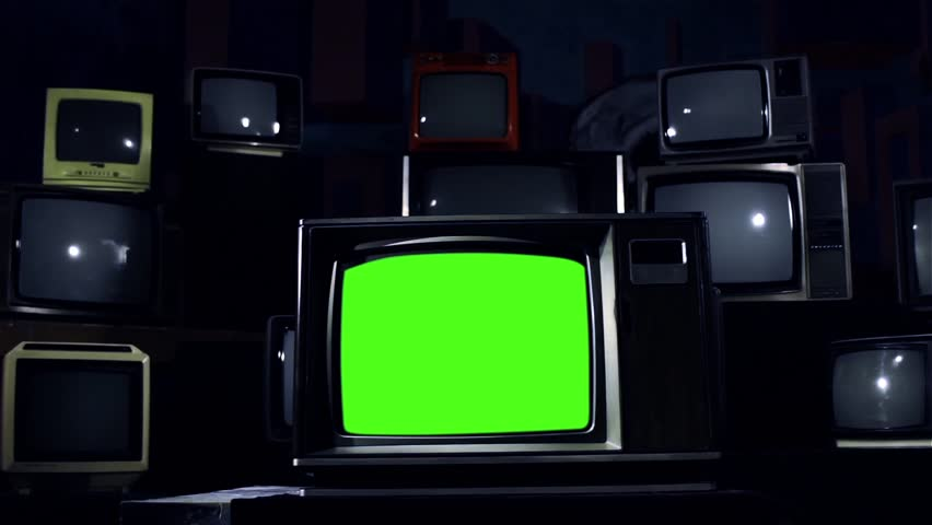 Old Tv Green Screen in the Middle of Many Tvs. Cold Steel Tone. Dolly Shot.  | Shutterstock HD Video #1009160552