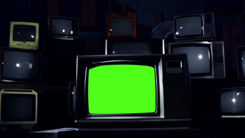 "Old TV Green Screen and Many Retro TVs. Blue Steel Tone. Dolly Shot. You can Replace Green Screen with the Footage or Picture you Want with ""Keying"" effect in After Effects (check out tutorials). 