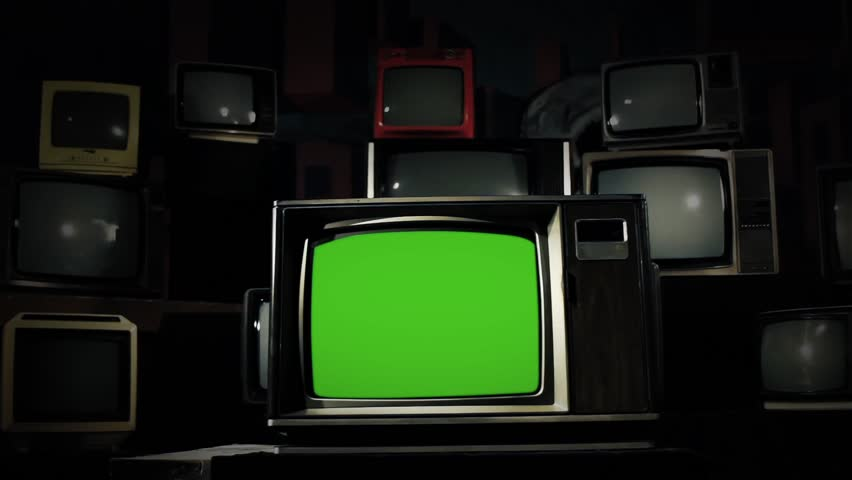 80 s Tv Green Screen in the Middle of Many Tvs. Steel Tone. Dolly Shot.  | Shutterstock HD Video #1009160792