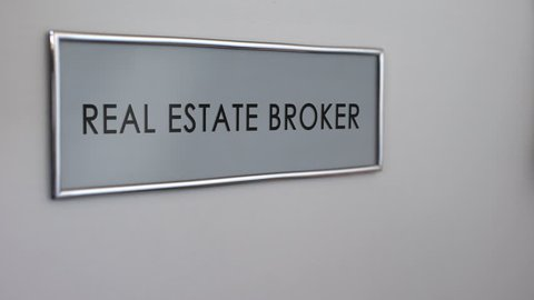 Real estate broker office door, hand knocking closeup, apartment purchase deal