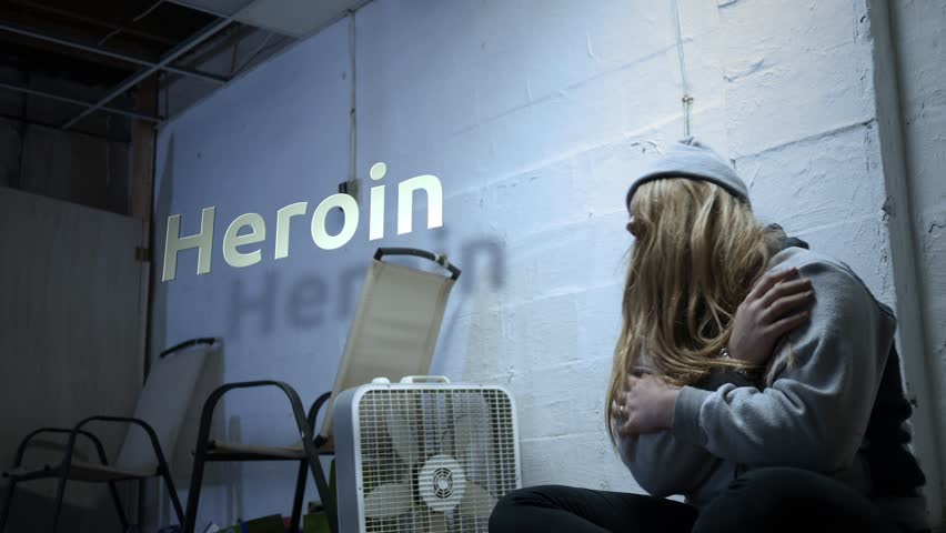A addict is struggling with withdrawal symptoms with text - Heroin